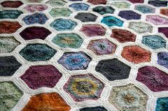 Our complex looking honeycomb throw is actually easy to make. Two shades of Keltic and a hexagonal motif make for a stunning throw. It is knit on straight needles with only one short seam joining each hexagon. (Berroco)