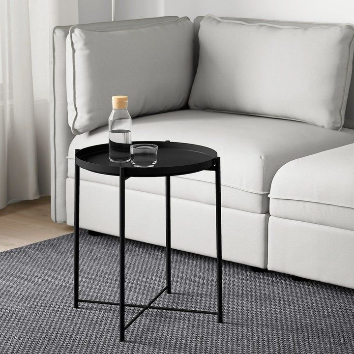 A simple small tray table designed so you can actually ...