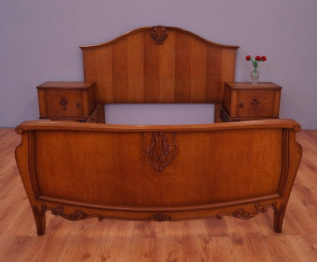 A very impressive french double bed with bedside tables in French style Richly carved, mounted on carved legs. Good condition, visible traces of normal use. Visible marks after woodworms.  Amazing and unique set! 2 Bedside tables with doors Stunning bed without bed slat. Mattress base : 140cmx200cm   Dimensions: Bed Height: 120/70cm Width177cm Length:208cm  Bedside tables: Height:58cm Width:55cm Deepth:35cm