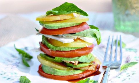 ... Heirloom tomato, basil, avocado and feta stacks with olive oil and