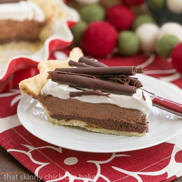 According to my family, I hit a home run with this Black Bottom Chocolate Mousse Pie! A pastry crust, a layer of chocolate ganache topped with chocolate mousse, whipped cream and chocolate curls...I think they're right!