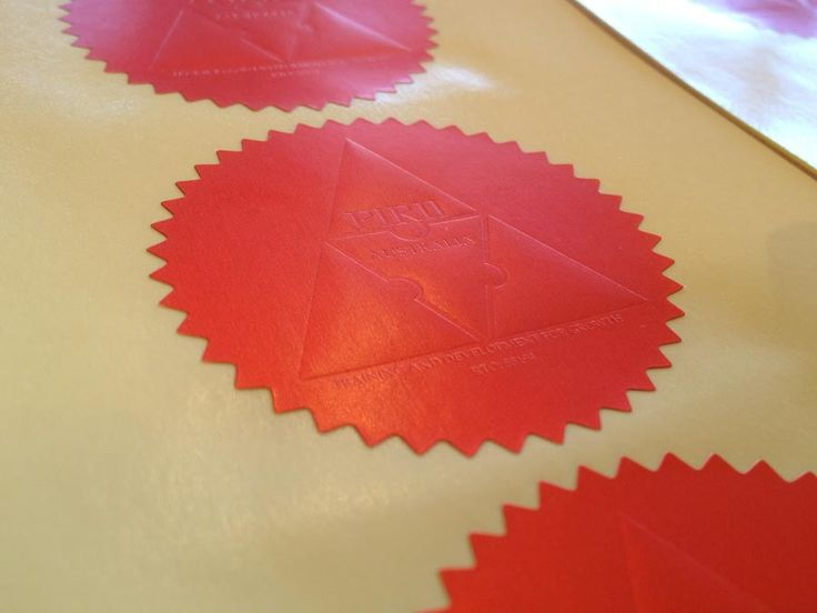 Embossed stickers on Red paper stickers material. These seals have been used on certificates.