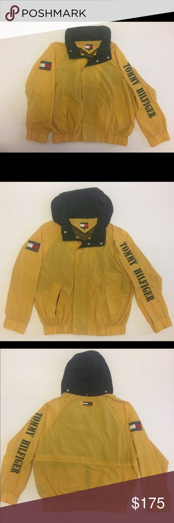 "Vintage Tommy Hilfiger Windbreaker Jacket L 90's Vintage Tommy Hilfiger Windbreaker Jacket. Men's L. Yellow jacket with Green embroidery. It's in excellent condition for it's age. I do point out all the tiny ""flaws"" or spots it has. Please see pictures for condition. I will be shipping out same day or next day! Tommy Hilfiger Jackets & Coats Windbreakers"