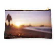 Man walking on beach at sunset square color analogue medium format film Hasselblad photograph Studio Pouch