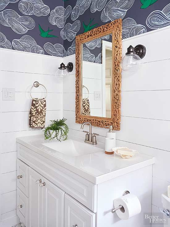 Add charm to a cottage bathroom with splashy purple and forest green. Seen here in a border of wallpaper, the colors stimulate without overwhelming and draw the eyes upward to visually expand the small space. White plank walls reflect the coziness of cottage style. Or this color