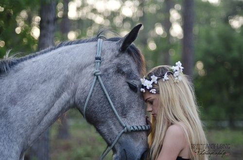 Love the pose for a mystical/boho shoot! A grey horse and a golden blond girl.