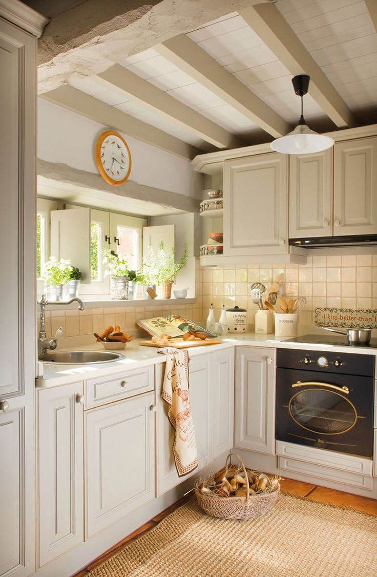 Farmhouse kitchen kitchen design decorating ideas housetohome co - Country Kitchen With Raised Panel Painted Wood Panel Ceiling Limestone Counters Terra Cotta Tile Floor Exposed Beam