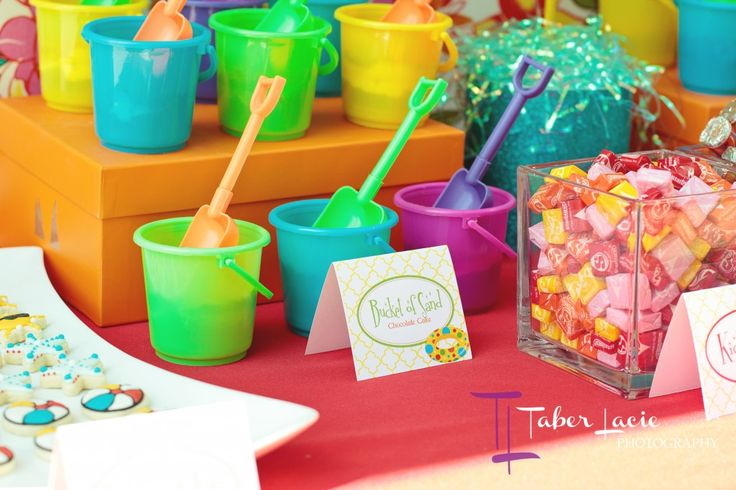 Love this idea of filling buckets with candy as a party favor for a summer/beach/pool party.