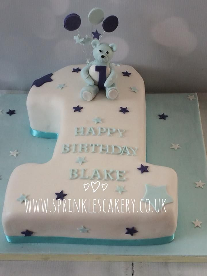 A  carved cake to celebrate a boys 1st birthday, finished off with a handcrafted edible teddy bear cake topper.