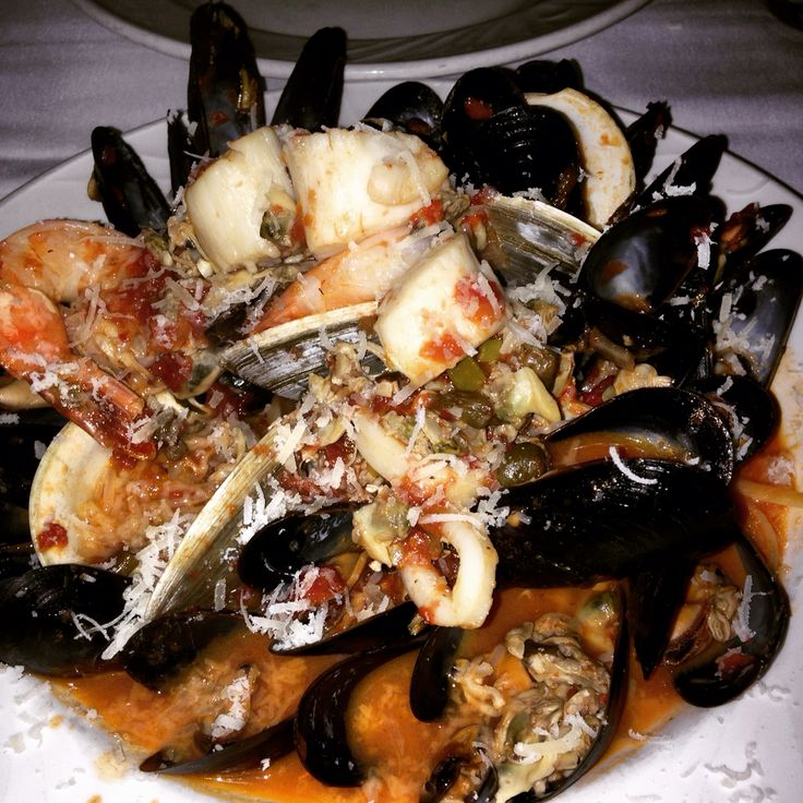 Seafood Pescatori a delicious seafood dish from Vago which is located on Green close to Atwater in Montreal. This pasta is filled with mussels, shrimp, scallops, calamari and  flavoured with a fresh tomato sauce