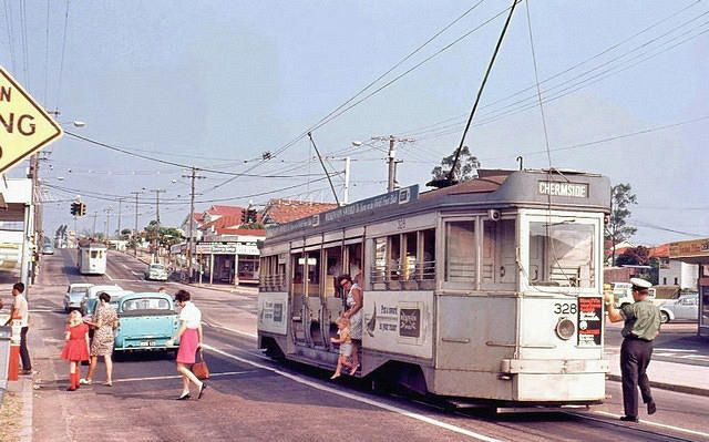 I remember going to school in the trams and electric trolley buses in Brisbane.  This photo brings back memories, especially the effort required to dodge the trams when trying to turn in a car.