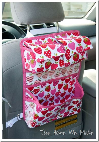A girl car organizer. Anna would love to be able to put her toys/books/sippy cup in this while she is in the car. I even have some strawberry fabric down in my craft room already. Hmm...