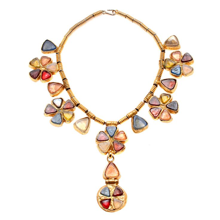 This is a rare piece from Gossens for CHANEL. The fabulous poured glass floriform elements have a Byzantine feel to them.