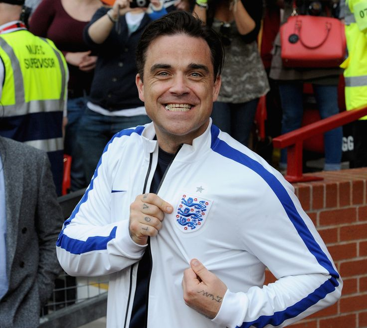 England assistant manager Robbie Williams ahead of Soccer Aid 2014 at Old Trafford on June 8, 2014 in Manchester, England.