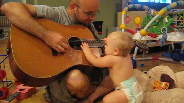 A classic father-daughter moment you may have seen before! Watch as an adorable 8-month-old baby girl rocks out with her dad while playing Bon Jovi's famous song, 'Wanted Dead or Alive'. Baby rocks out with dad playing Bon Jovi. Source: Baby rocks out with dad playing Bon Jovi by Aaronfoye on Rumble
