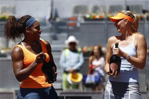 Queen of Madrid Serena Williams  Runner-up Maria Sharapova Atop The Trophy Ceremony's Podium...Serena cruised past her 6-1, 6-4 to win a pinnacle 50th Career Title, but here's Maria chatting it up with Serena prior to departing for Rome where Maria is the Defending Champion.