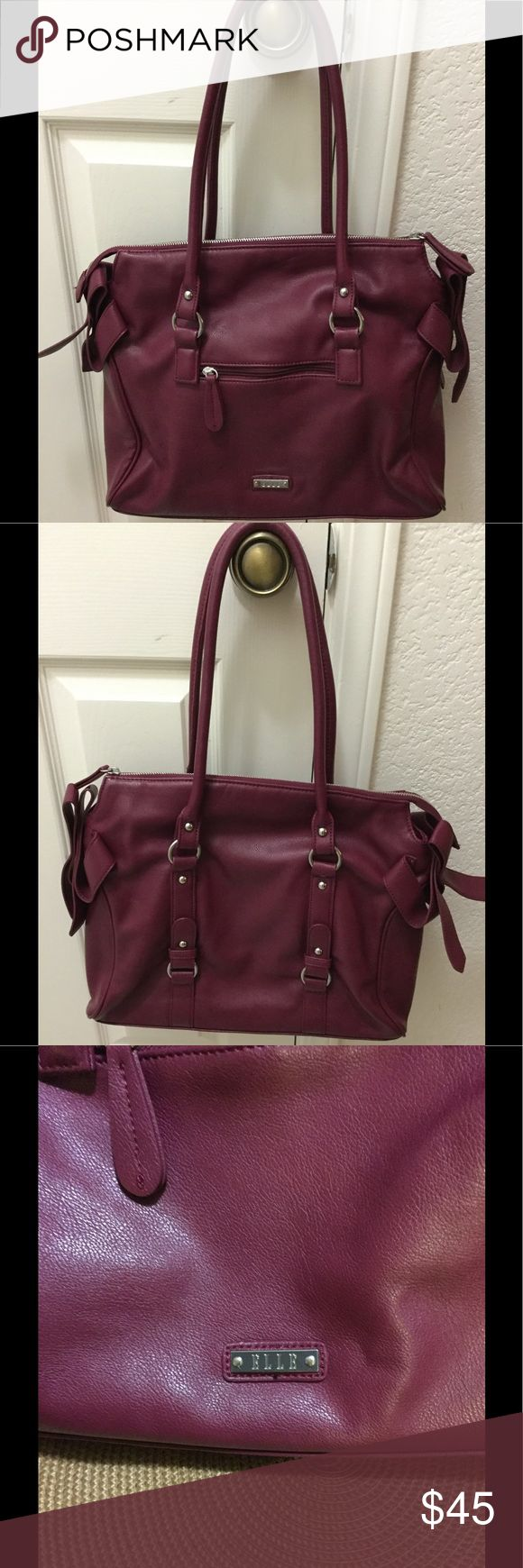 """Elle Shoppers bag. Elle Shoppers bag in a gorgeous raspberry, its in like new condition with no flaws, super clean inside with just a tiny spot. Smooth zipper closure, one zipper pocket inside with two slots to organize you. 9"""" strap drop. Fun polka dot interior. A must have!! Bags Shoulder Bags"""