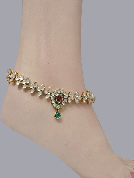 Kundan Indian Jewellery -Anklet A beautiful Indian traditional accessory for your feet called anklet, pajeb or payal with famous Kundan craftsmanship. A string studded with white, green & deep red color stones and kundan making you look stylish and trendy. Can be worn on any outfit.