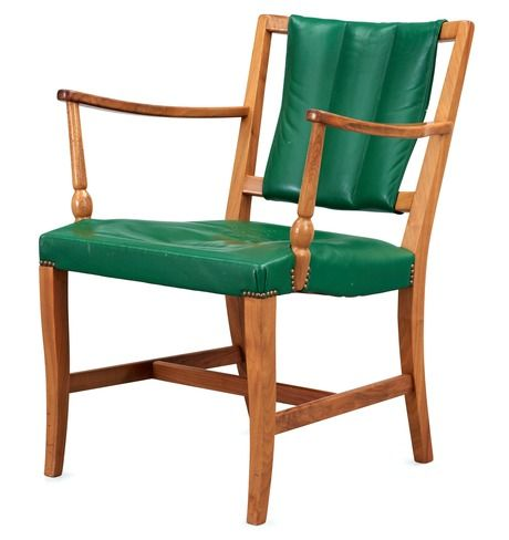 A Josef Frank mahogany and green leather armchair.   By Svenskt Tenn.