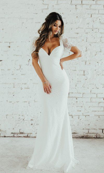 The backless gown white lace sleeve wedding dress from Handmade Dress