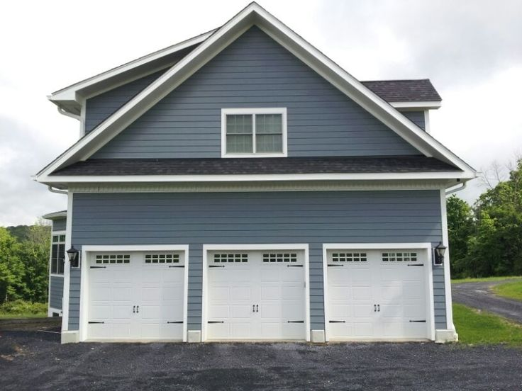 Raynor Garage Doors Showcase Carriage Stamp Overhead Doors installed in Rhinebeck, NY.