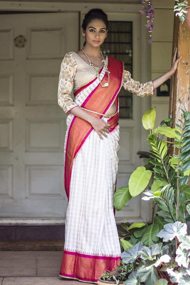 Festive season beckons and what is better than the ever graceful subdued pattu silk saree for that? A little traditional, a little alternate, this subtle beige white checked silk saree aces the stylish-yet-traditional look. A soft palette in checks with a pop of vivid fuchsia! you will be on your way to parent-approved and all other approved, through and through. #houseofblouse #festive #saree #puresilk #blouse #indianwear #india #fashion #bollywood