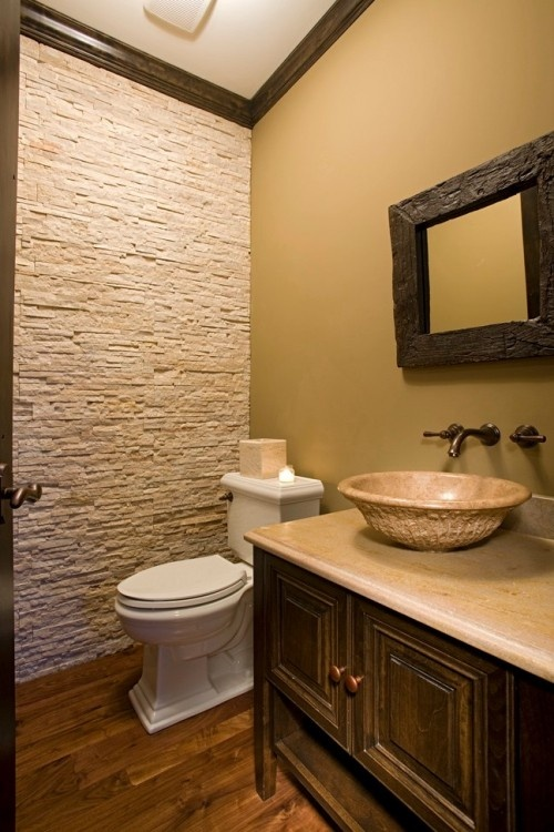 Downstairs bathroom.  Pinned only for the pizzaz one wall of faux stone gives this room