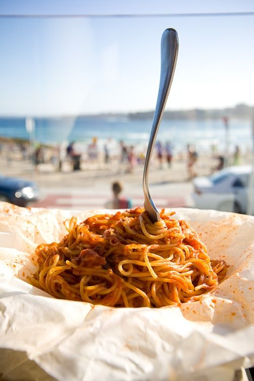 A big bowl of spaghetti at the beach, sounds too good.