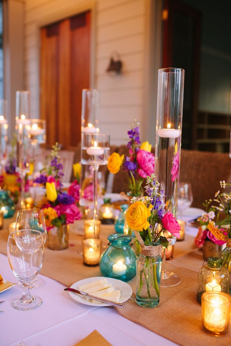 Tablescape of colorful mixtures of vessels and candles-  love this look!