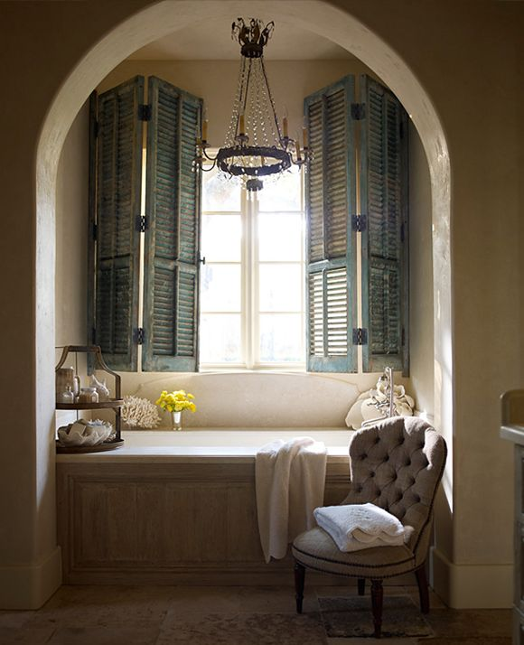 love the shutters and the wood paneling in front of tub