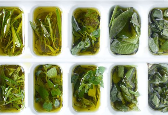 Preserve your fresh herbs by freezing them in olive oil. Just snip clean herbs into ice cube trays and cover with olive oil. (about a tablespoon) Store the frozen cubes in a container in your freezer and pop one in whatever you're cooking. Savory herbs such as basil, thyme, rosemary and chives work beautifully.