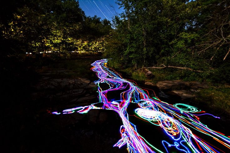 A friend and I brought over 100 glow sticks into the woods. My friend went up stream and threw the glow sticks in the stream while I gathered them down stream. I built a net with chicken wire to try and catch the glow sticks, but I still ended up chasing after some that made it through somehow. This is 319 photos merged into one image using the lighten layer-blending mode in photoshop.