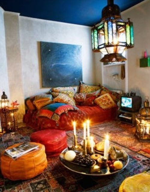 In my opinion, what's not to like in this bohemian living room?  Grouping candles on a tray is a good idea.