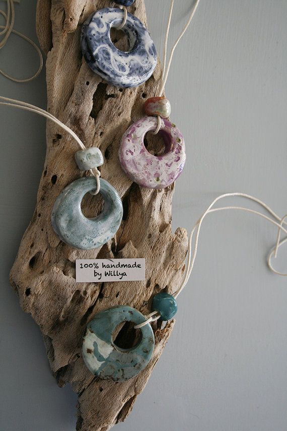 Handmade ceramic pendants glazed in different colours. See Willya Collection on ETSY.