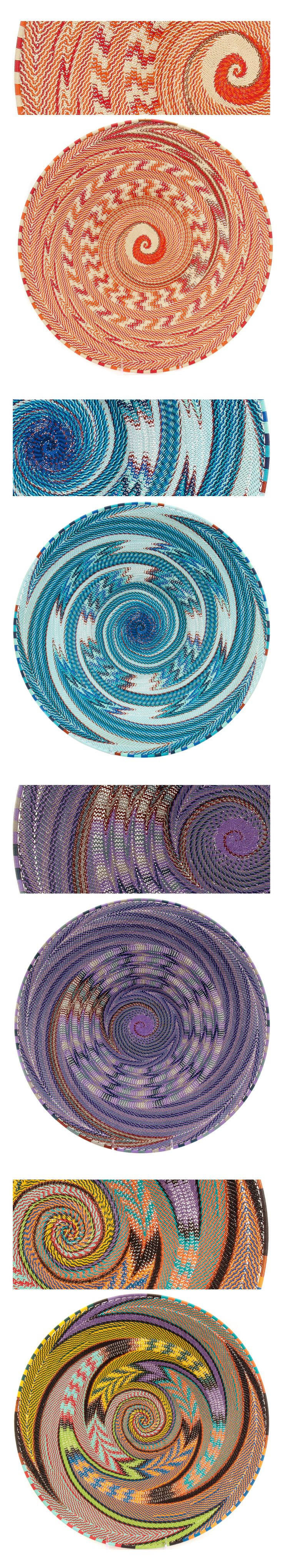 "Masterweave platters by Ben Makhanya  |  Zulu ""Telephone Wire"" baskets are vibrant and mesmerizing, but weaver Ben Makhanya creates pieces that are far superior to the rest. Wire baskets are woven by wrapping the rim FIRST, then working in toward the center of the bowl, which is backwards from traditional basket weaving. Ben Makhanya manages to wrangle more colors and more changes in direction and more special weaves into his platters, creating a pattern that seems to swirl as you look at…"