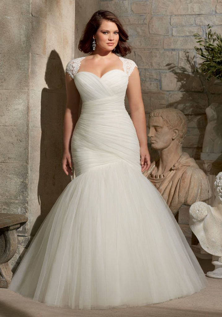 Soft Net- Removable Shoulder Cover with Alencon Lace Appliques Plus Size Wedding Dress. Colors available: White and Ivory. Designed by Madeline Gardner.
