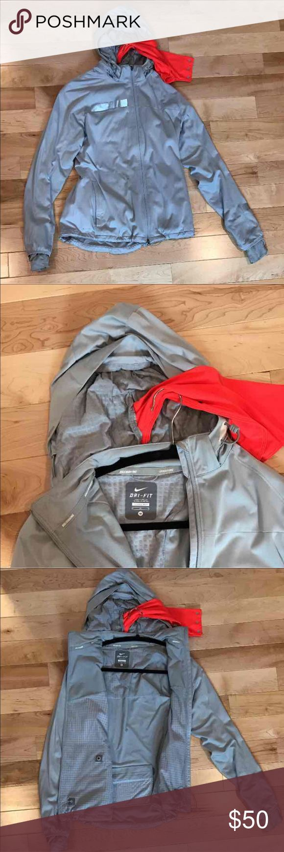 Nike Running Jacket Nike women's running jacket. Color is a Grey with a blue undertone/Silver. The reflective stripes are silver. This jacket is for running in very cold weather. It is a little thicker than your usual running jacket. Nike Jackets & Coats