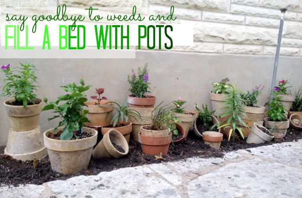 Unique garden bed made with clay pots!