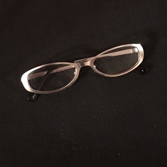 1.00 readers in matte silver frame EUC 1.00 reading glasses in matte silver frames. No scratches. Goes with everything with neutral silver color! Accessories Glasses