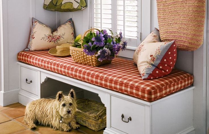 Create a welcome place to pull on shoes or set down packages. Here, a cubby keeps trip hazards safely stowed and drawers help organize small items, such as dog leashes and toys.
