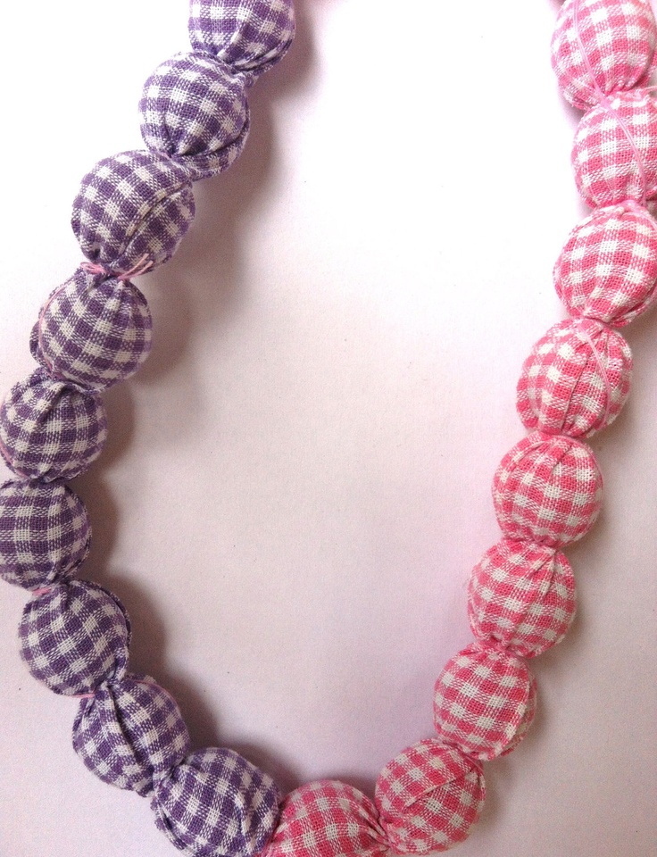 Fabric Necklace in pink and purple colors (made to order). $32.00, via Etsy.