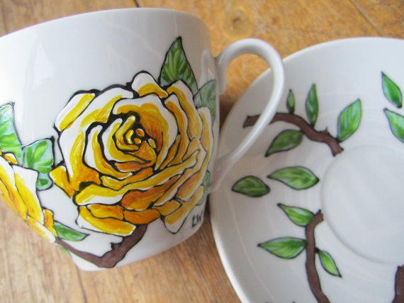 Hand painted yellow rose tea cup and saucer via Etsy
