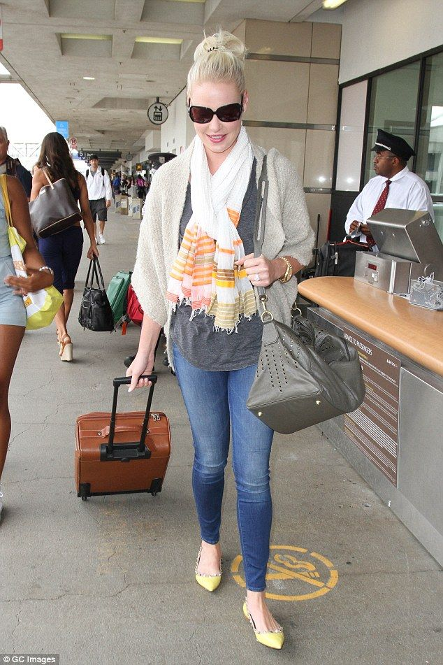 Something for the weekend? Katherine Heigl looks delighted to be heading through LAX on Friday, just in time for Labor Day Weekend