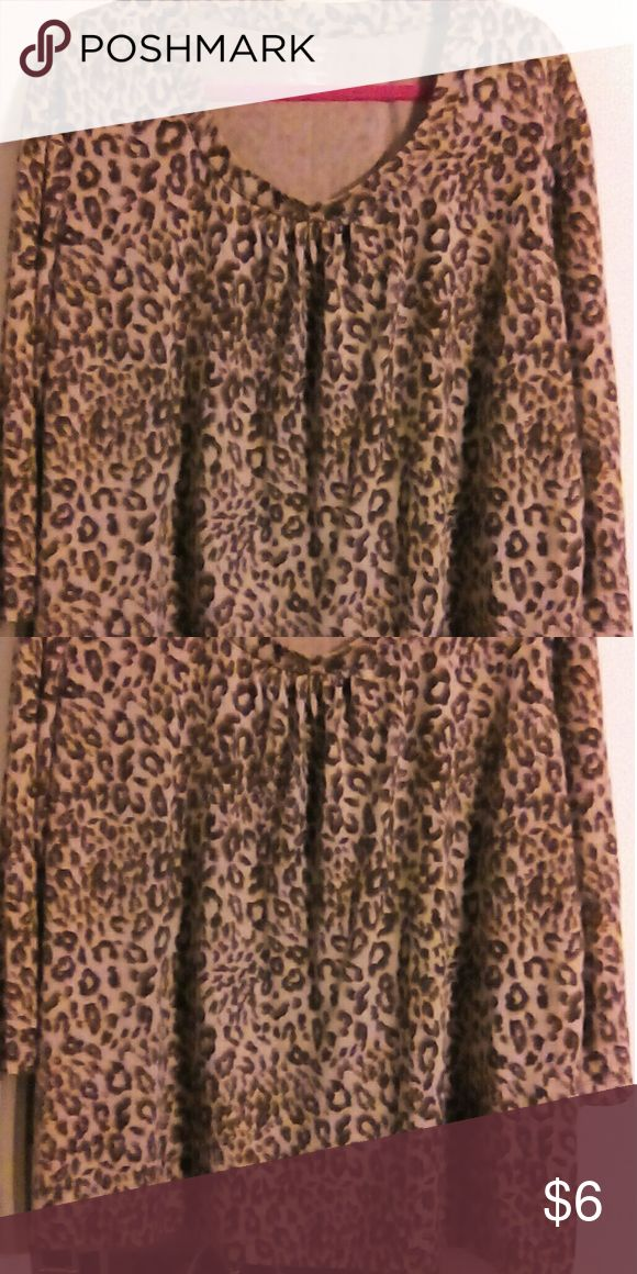 Cute top by Jennifer Lauren size 2X cute top size 2X animal print 3/4 sleeved polyester rayon spandex in very good condition Jennifer Lauren Tops