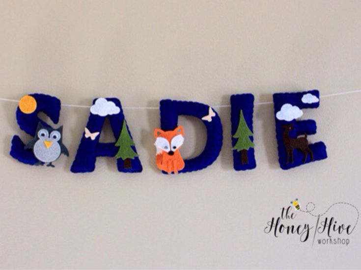 Felt name banner, woodland baby name garland, animal nursery, woodland nursery, woodland animals, felt letters, personalized baby name by TheHoneyHiveWorkshop on Etsy https://www.etsy.com/ca/listing/529397078/felt-name-banner-woodland-baby-name