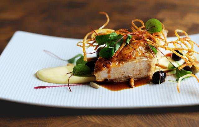 Roast chicken breast, potato purée and pine nuts