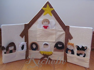 Nativity finger puppets in their stable