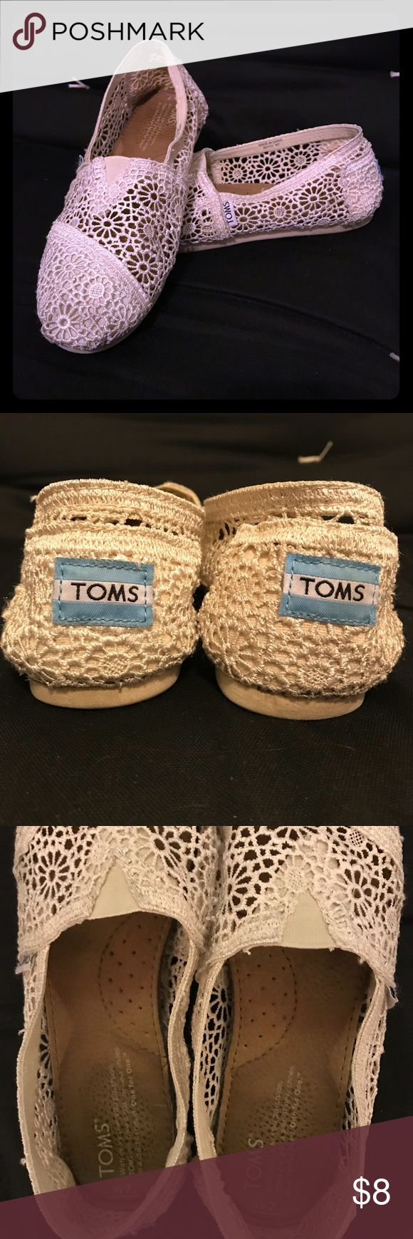TOMS Crochet Classic Slip-On Lovingly worn TOMS crocheted slip-on shoes. Natural/cream color. There's one dark spot on the right heel that I was unable to wash out. It's kind of underneath and not easily visible (see photos). Selling at low price due to wear and tear, but always willing to negotiate! Toms Shoes Flats & Loafers