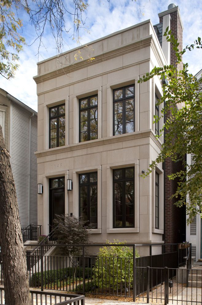 brooklyn limestone Transitional Exterior Decorating ideas Chicago black fence black railing black stair railing brick chimney english basement house number limestone exterior outdoor lighting outdoor staircase Two-Story wall sconces