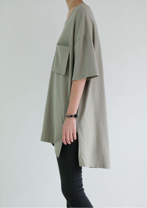 Oversized shirt to pair with a very tight, black skirt that is between mid calf to just below the knee
